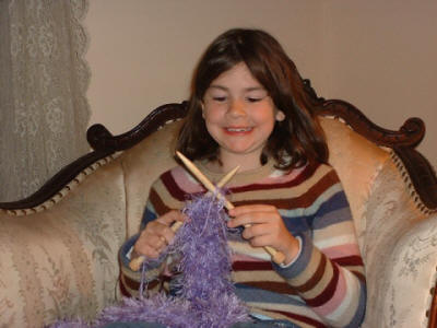 Knit Heaven Kids' Corner Child knitting - This photo is the property of KnitHeaven.com © 2004-2010 and may not be used without permission